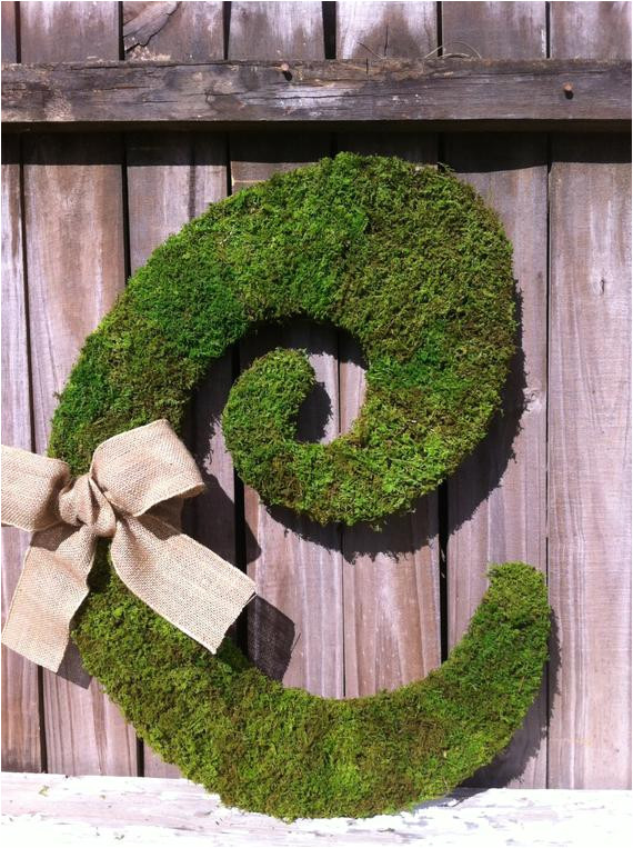 large moss covered letter c rustic