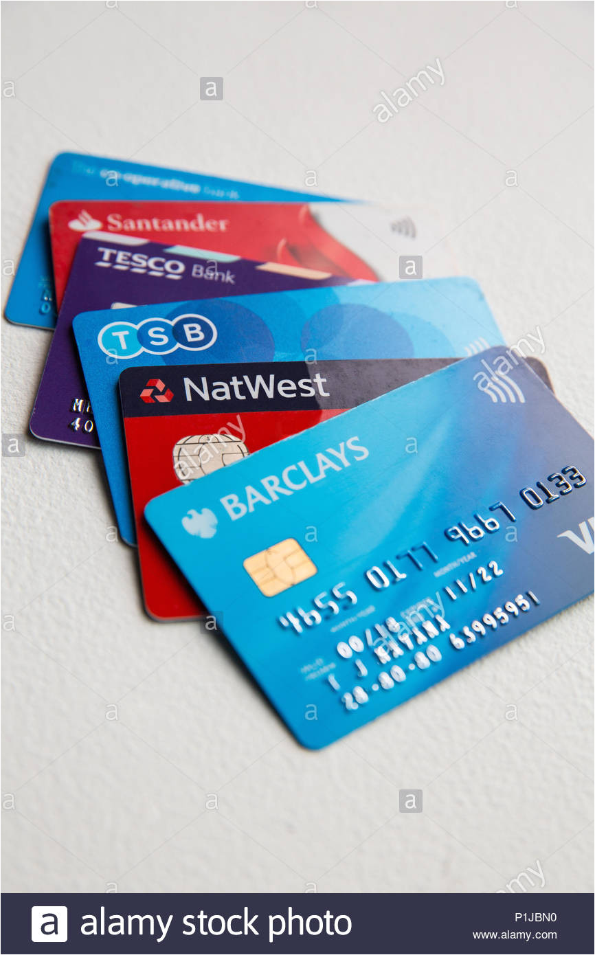 five visa debit cards in a pile on a white background including tesco tsb barclays co op natwest and santander p1jbn0 jpg