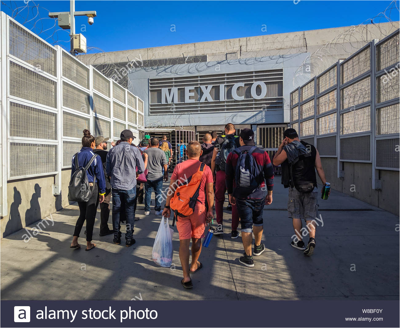 pedestrians at the pedeast usmexican border crossing in san diego california w8bf0y jpg