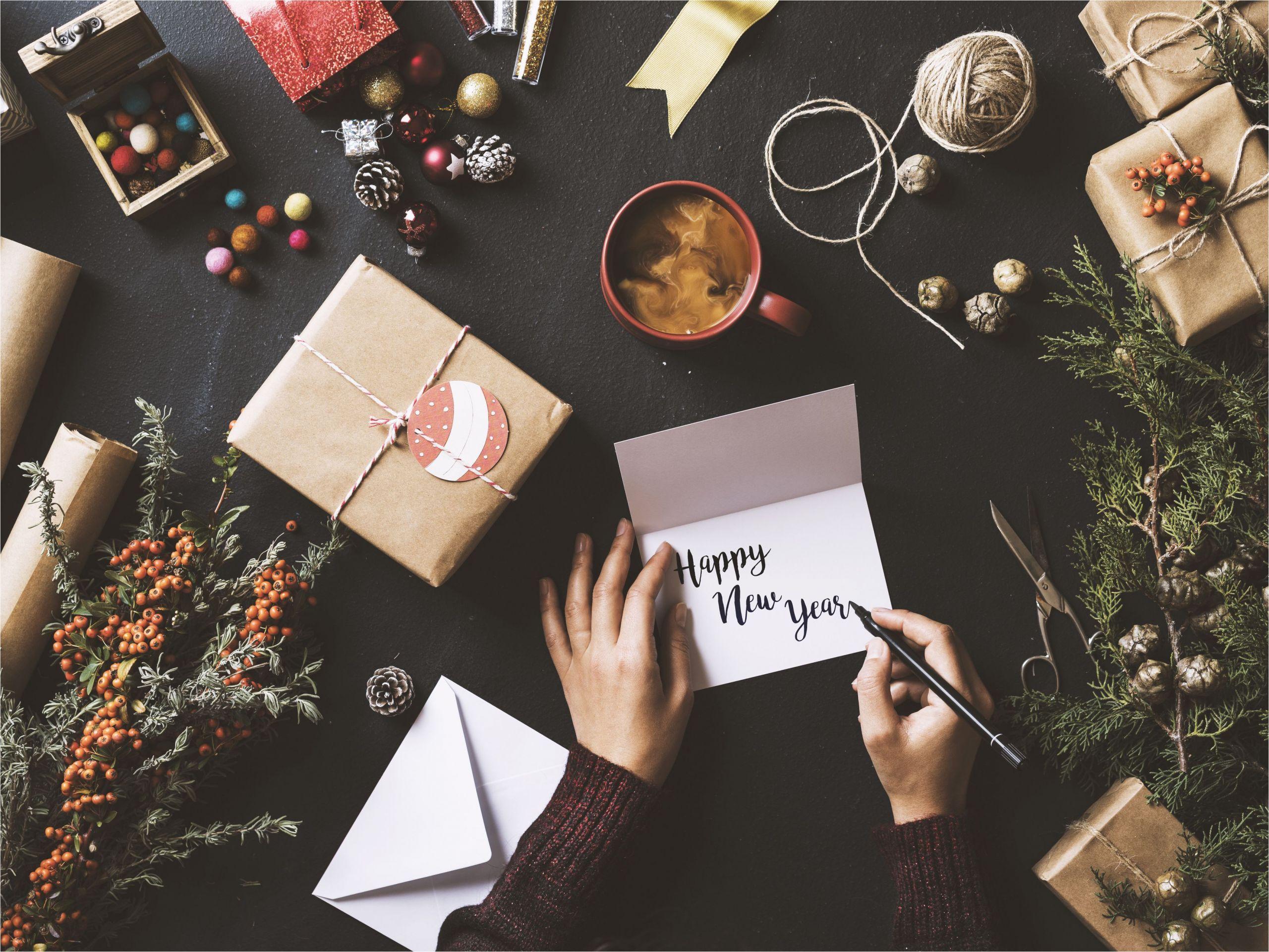 writing new year cards table top flat lay 628016248 5bde516046e0fb00268d5ddb jpg