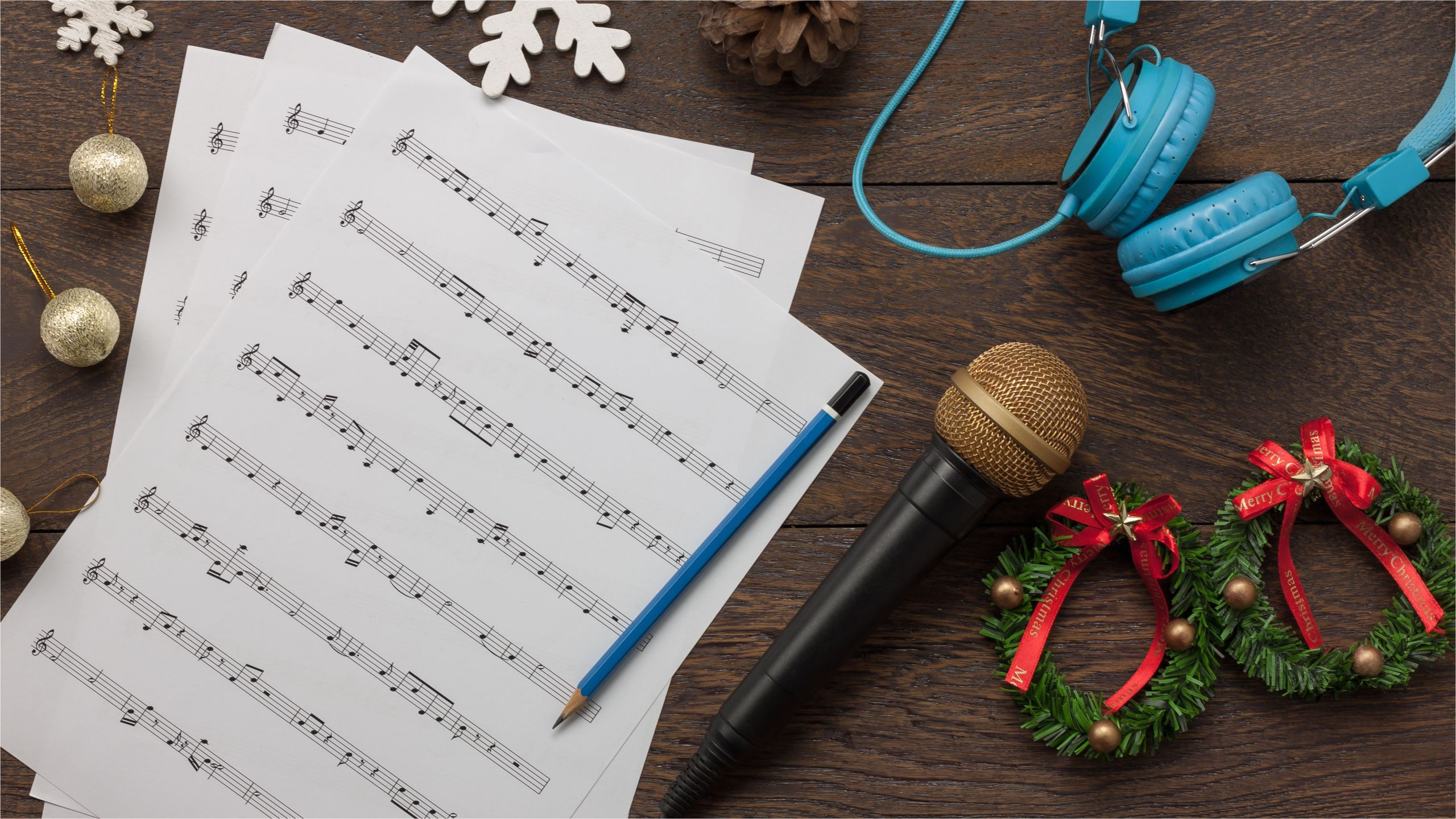 table top view of music sheet note and accessories merry christmas happy new year concept instrument musical with decoration festive on the modern rustic dark brown wooden at home office desk 865548576 0c8520ffa2904d06a2b2eb04edc379d2 jpg