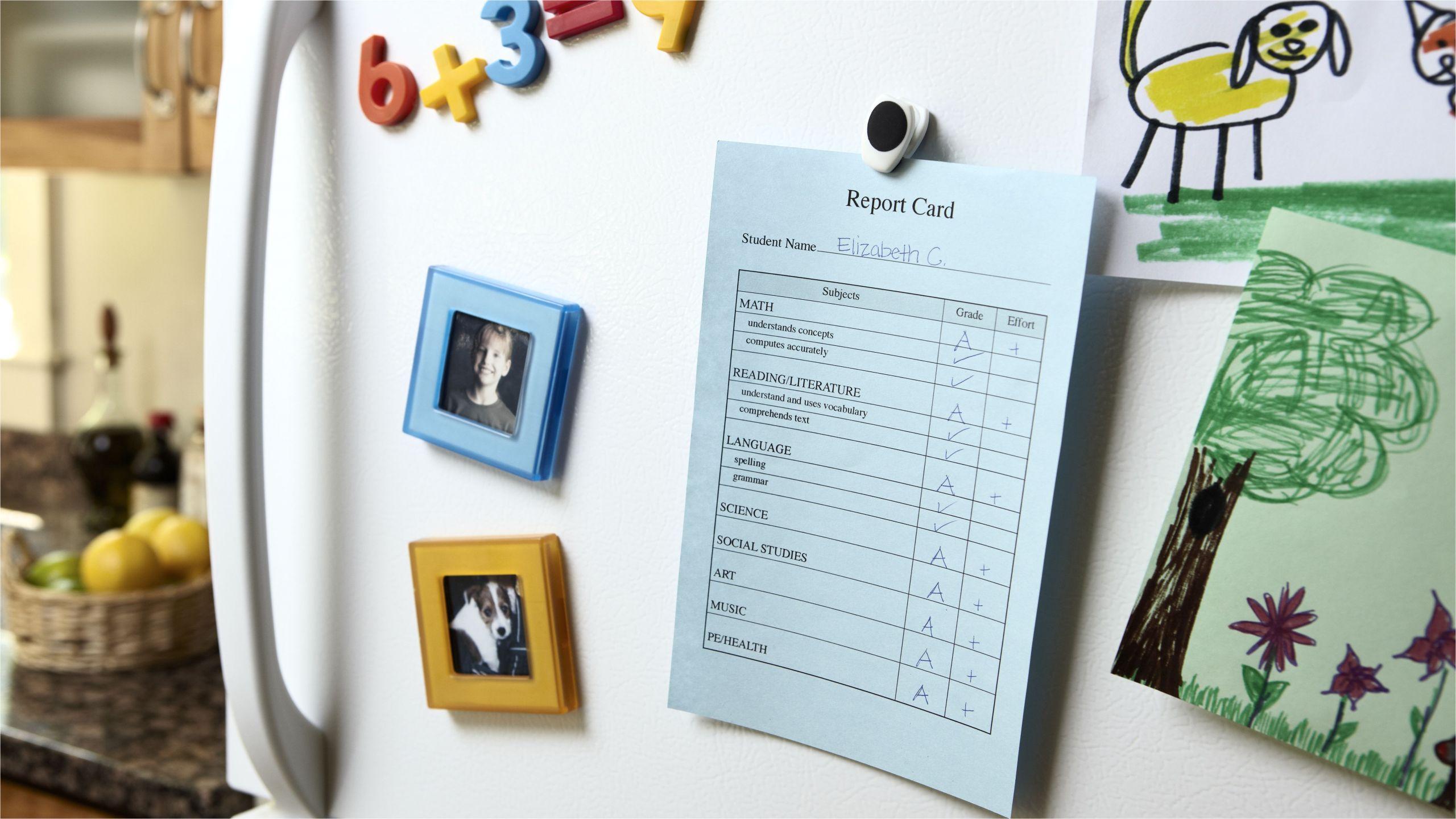 report card on refrigerator 103631251 5c4e524a46e0fb0001f21fbd jpg