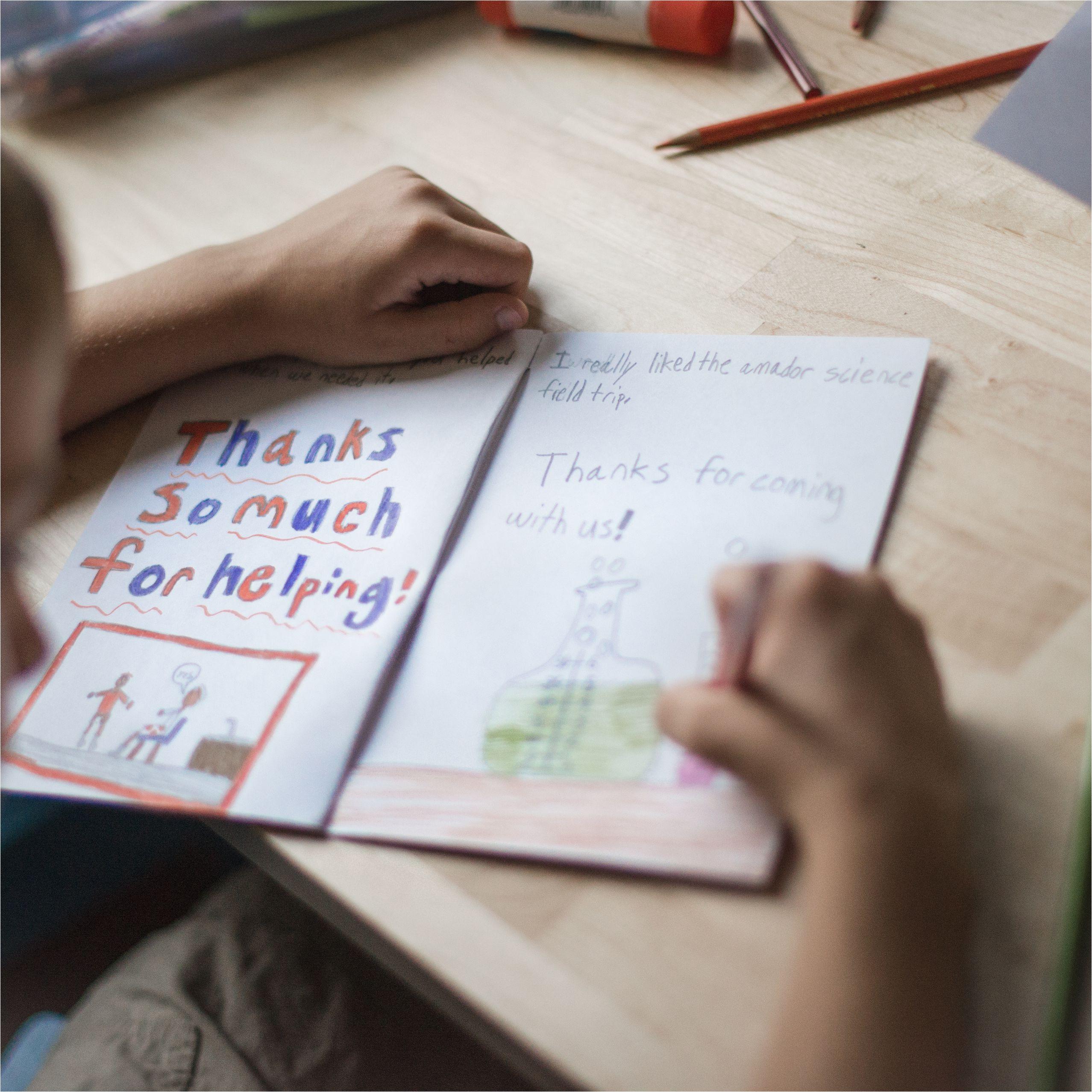 boy making thank you card for teacher 510733815 5ac8de0b3128340037de1270 jpg