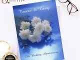 Anniversary Wishes Card with Name This Beautiful Image Shows White Flowers On A Blue Lighted