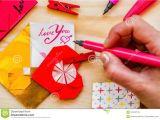 What to Write In Wife S Valentine S Card Valentine S Day Holiday Woman S Hand Writing with Pink Pen
